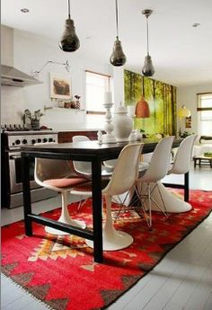 I like a bold semi traditional rug in a modern kitchen...maybe not this rug in this kitchen, but that idea ;)