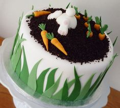 I made this funny bunny carrot cake with inspiration from many others here on Cake Central! It& -ofcourse- carrot cake inch) inside. Soil is dark chocolate cake finely grated in a blender. Cake Central, Easter Bunny Cake, Easter Treats, Bunny Cakes, Food Cakes, Fondant Cakes, Cupcake Cakes, Easter Cake Fondant, Sweets