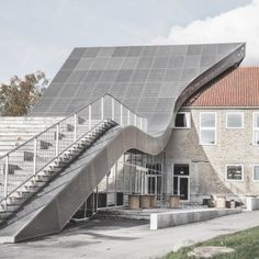 Concave roof creates a form which blends in with the hilly landscape | Mariehoj Culture Centre | Sophus Sobye Arkitekter