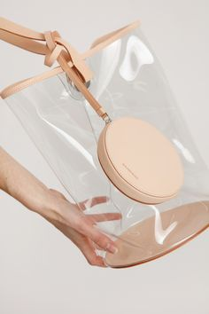 Clear PVC, Veg Tan leather shoulder strap on piping and base, Magnetic closure, Includes small Veg Tan circle zip pouch, Heat welded seams 32 × 20 cm, strap drop 33 cm 778$ canadian Dollars