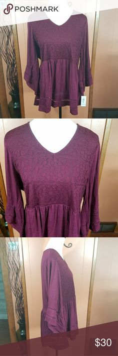 Plus size burgundy babydoll top This flowy top is the most beautiful wine color. It is a deep burgundy color. The top part is covered in matching lace. It has an empire waistline and bell sleeves. Three-quarter sleeves. There is a slight high-low hemline. Please feel free to ask questions about size and fit before purchase.  Baby doll, flowey, swing, boho, bohemian, burgundy, wine, dark purple, maroon. Style & Co Tops