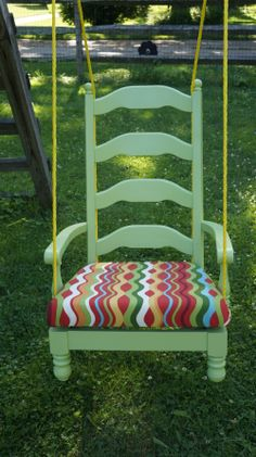 """Chair swing -  Found the captain's chair at a garage sale and cut the legs off.  I Spray painted the chair Green Apple by Rust-Oleum. The cushion is removable and I covered it first in plastic and then outdoor fabric. I used a 3/8"""" poly rope and carabiners to attach the swing to our existing chains on our swing set. Since the cushions come off, I just ran the rope under through the chair and didn't have to drill any holes. Very comfy.  DML 5/2014"""