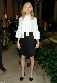 Dainty and demure: Kate Bosworth chose a delicate white blouse and slim black skirt to we...
