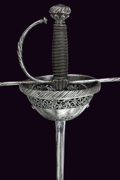 Cup-hilt Rapier Dated: 17th Century Culture: Italian Measurements: overall length 124 cm
