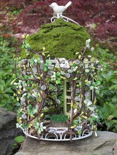 Cute fairy house made from a bird cage...this inspires me! I have an old brass birdcage, that would work nicely!