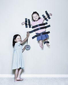 Wedding Photographer Jason Lee's Creative Portraits of His Daughters    Now what an easy concept of getting the impossible photograph of two siblings that dont want to appear in the same photo. LOL!