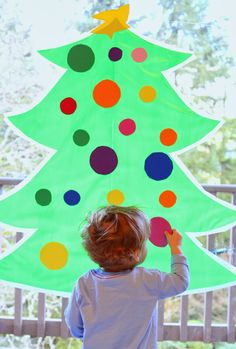 Sticky Kid-Sized Christmas Tree with reusable ornaments - you can decorate all season long! From Fun at Home with Kidstam jest link do jeszcze jednego superprojektu z filcu! Paper Christmas Decorations, Christmas Trees For Kids, Christmas Crafts For Kids To Make, Christmas Activities For Kids, Preschool Christmas, Winter Christmas, Christmas Themes, Toddler Activities, Holiday Crafts