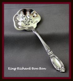 S ORCHIDS MULTI MOTIF TOWLE STERLING DEMITASSE SPOON
