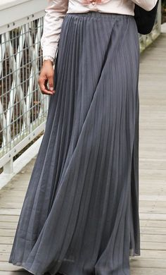 Pleated maxi skirts available and grey fuchsia and purple in sizes small through extra large