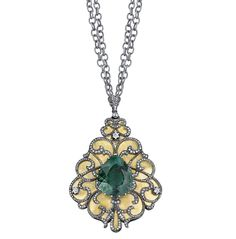 Arman Sarkisyan pendant with blue tourmaline, diamonds and oxidised silver.