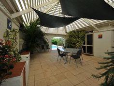 Indoor-outdoor outdoor living design with pergola & outdoor furniture…