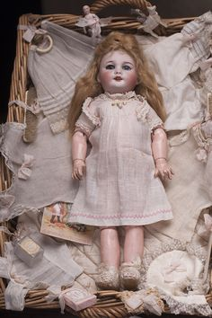 Rare Antique French SFBJ 301  22-2  Bleuette doll with an original basket, accessories from Au Nain Bleu shop