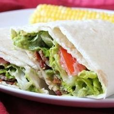 """B.L.A.T. Wraps I """"Great Recipe. It was an immediate hit with my family. This recipe can be made with or without the avacados. Quick Tip: Slice bacon into small pieces before cooking."""""""
