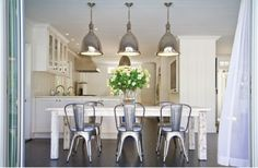 tolix chairs, industrial lamp & farmhouse table by leila
