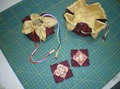 Image result for Passo-a-passo da flor de tecido em origami.
