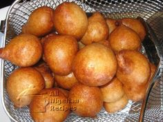 Art Goes on Vacation: Nigeria Puff puffs are just like doughnuts but spongier! This dessert is seen at parties all across Nigeria Read Recipe by ideamuseum Snack Recipes, Cooking Recipes, Snacks, Donut Recipes, Churros, All Nigerian Recipes, African Recipes, Nigeria Food, West African Food