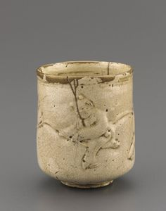 Satsuma ware cylindrical cup for steeped tea  19th century      Edo period     Stoneware with clear, colorless glaze; gold lacquer repairs   H: 8.4 W: 7.1 cm   Japan