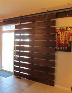Modern Barn Door DIY. I need to find out more about the hardware and mounting because I have an old door I want to mount like this in my bedroom.