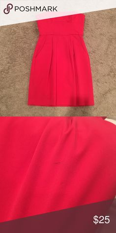Red dress Red strapless dress....has barely been worn....one small mark on left side front of dress but hardly noticeable when being worn...very flattering and cute dress!! BCBGMaxAzria Dresses Strapless