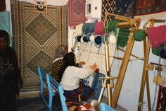 https://flic.kr/p/6F5ayD   Carpet weavers at Kairouan   The medina, with its imposing walls and monumental gates encloses lovely mosques, an ancient well and hundreds of shops where world famous Kairouan carpets of pure wool are woven and sold and where the visitor can admire the handicrafts of artisans in copper, leather, and in the traditional jebba and burnous, ornate and richly adorned or elegantly natural . The artisanat Center provides an excellent exhibit on carpets and carpet…