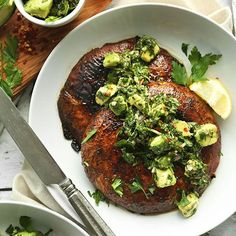 Grilled, marinated portobello steaks with a spicy avocado chimichurri sauce! An incredibly hearty and flavorful 30-minute plant-based meal!