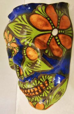 Hawaiian Smile-Handmade Sugar Skull Wall Pocket by LeavesofRed  I just put up  about 5 new sugar skull wall pockets, please come check them out.