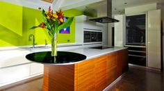 The bright green wall causes maximum impact in this kitchen