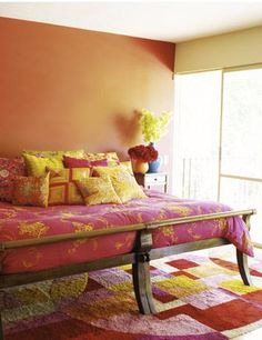 Love the bright and bold color combination, and the pile of pillows.  I have a weakness for pillows.