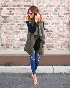 This gorgeous and plush vest is fully lined and fits like a dream! We love the ultra soft wear of this statement piece in olive. Snuggle up in our Whistler Vest! The draped lapels can be worn open or