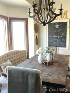 Dining Room Restyle: tufted bench, parsons chairs, rustic table, wood chandelier and a chalkboard. Getting there!