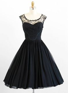 Incandescent 1950's black silk chiffon and chantilly lace cocktail party dress. By Karen Stark for Harvey Berin.