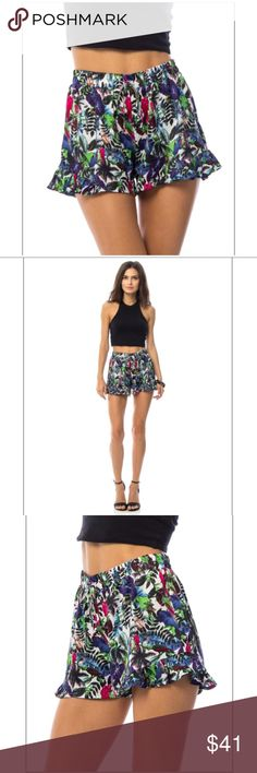 Blue Tropical Print Ruffled Hem Shorts Blue tropical Print ruffled hem shorts. 100% polyester. Shorts