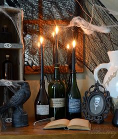 For Halloween, decorate your table with an old Victorian book, faux cobwebs, and black candles.