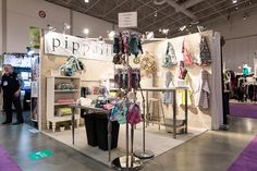 2015 One of a Kind Spring Show, Pippalily - open corner booth. Lighting is key here in creating an inviting space for customers who will want to come into your booth.