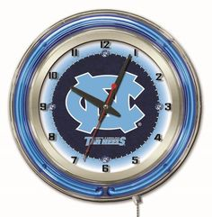 """The North Carolina Tar Heels 19"""" Diameter Clock is made in the USA and features neon accent rings, perfect for Tar Heel fan caves and dorm rooms"""