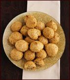 A recipe of easy to make cheesy poofs called Gougeres from a chef who may know what he's doing. Easy, delicious, and addicting.