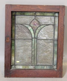 ARTS AND CRAFTS STAINED GLASS PANEL IN OAK FRAME        Price: $85