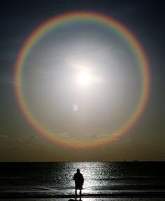 perfect rainbow around the moon,  a full moon