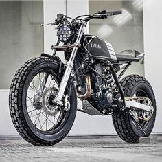 "bike-exif: ""looks like a bundle of fun, doesn't it? According to builders Kyle Scott and Chris Clokie, ""The idea was to produce a stripped down, street-legal custom bike inspired by the flat track racing scene."" The rider is a lady new to the. Honda Dominator, Ducati Scrambler, Xt 600 Scrambler, Yamaha Tw200, Motos Yamaha, Scrambler Motorcycle, Scrambler Custom, Street Scrambler, Flat Track Racing"