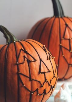 Do this string art on fake pumpkins from Joanns