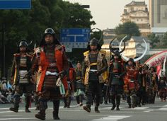 People dressed in Samurai costume and helmet march during the annual Himeji Castle Festival on August 3, 2013 in Himeji, Japan. The parade of Castle Queens is part of the traditional matsuri festival around the UNESCO world heritage Himeji Castle. (Photo by Buddhika Weerasinghe/Getty Images)