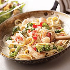 Shrimp & Broccoli Fettuccine    Ingredients:  1/4  pound fettuccine, 1 cup broccoli florets, 3/4  pound frozen cooked cleaned medium shrimp, thawed, 1 clove garlic, minced,1  10  ounce tub PHILADELPHIA Savory Lemon & Herb Cooking Creme, 1/4  cup milk ,1/4  cup chopped tomatoes