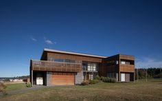 Versteckt hinter dem Holz: Holzlatten verbergen ein wunderbar modernes Haus