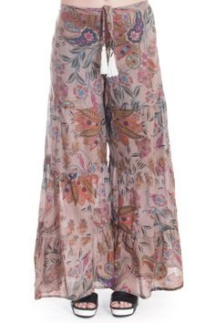 Channel your inner Flower Child in these Z & L Europe Wide Leg Beach Pants. A punchy paisley print in muted neutral tones adorn these wide leg ruffled cropped hem pants. A tie waist and tassel detail make these pants laid-back boho.  Printed Beach Pant by Z&L Europe. Clothing - Bottoms - Pants & Leggings - Flare & Wide Leg New York