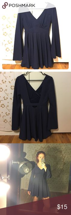 Long Bell Sleeve Dress Dress : long sleeve, bell shaped sleeve, open back, flat navy colour. Fitted around ribs and float from waist down. Very comfortable. Mostly dressy. Lizard Thicket Dresses Long Sleeve