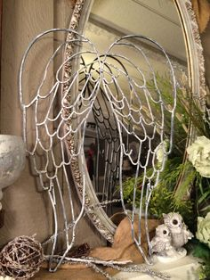 White washed metal angel wings. Measures apx. 24x17. This is one set attached in the middle.