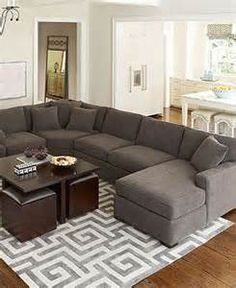 """For the """"pit"""": a charcoal sofa would be nice. If it's modular we can rearrange it according to our needs."""