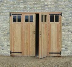 Wooden garage doors in a variety of Softwood and Hardwood timbers inc Douglas fir and Iroko. Garage door designs in solid timber, glazed and Bi folding to suit most locations. Ssuitable as barn and shed doors. Supply only or fitted within 5 mile radius. Timber Garage Door, Diy Garage Door, Modern Garage Doors, Garage Floor Paint, Garage Door Styles, Garage Door Makeover, Garage Door Design, Modern Door, Modern Rustic