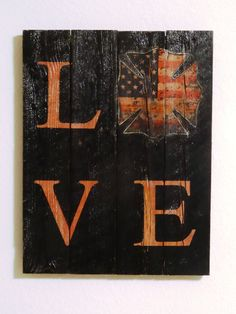 "Reclaimed Wood Firefighter Sign - ""Love"" with Maltese Cross - Black painted reclaimed wood with pink letters by BellaRemiDesigns on Etsy"