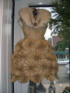 A dress I saw in Sensible Pearl's (in Suttons' Bay)--made from brown recycled paper. Would kill to be this crafty.